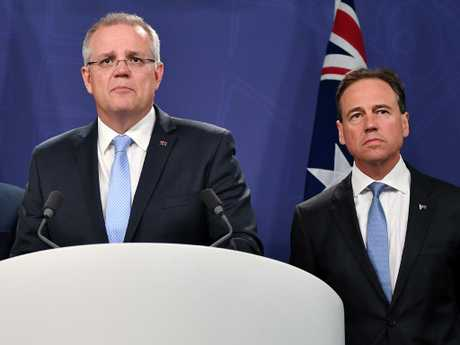 Prime Minister Scott Morrison and Minister for Health Greg Hunt speak to the media. Picture: AAP