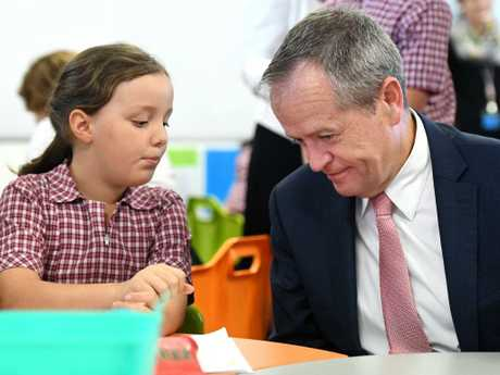 Federal Opposition Leader Bill Shorten with Year 3 student Charlotte Peterson at Marsden State School, south of Brisbane, yesterday. Picture: Dan Peled/AAP