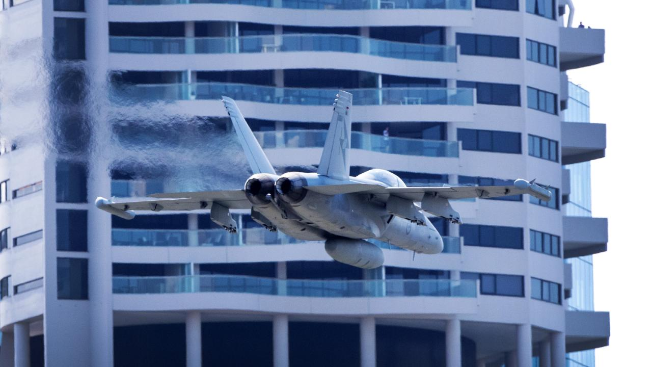An RAAF EA-18G Growler goes through its manoeuvres along the Brisbane River a day before Riverfire. Picture: Nigel Hallett