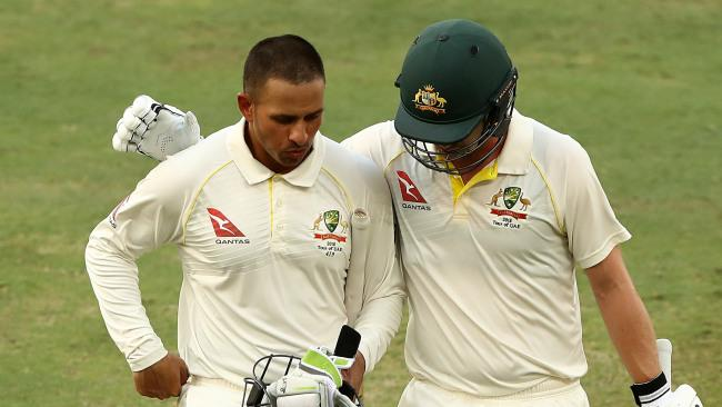DUBAI, UNITED ARAB EMIRATES - OCTOBER 10: Usman Khawaja of Australia and Travis Head of Australia walk from the ground at stumps during day four of the First Test match in the series between Australia and Pakistan at Dubai International Stadium on October 10, 2018 in Dubai, United Arab Emirates. (Photo by Ryan Pierse/Getty Images)