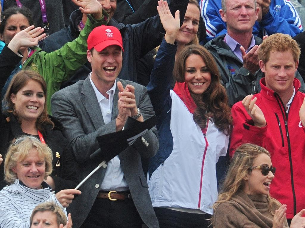 A right Royal good time (L-R): Princess Eugenie, Prince William, Catherine, Duchess of Cambridge, and Prince Harry, celebrate as Great Britain's equestrian team, including their cousin Zara Phillips wins a silver medal in the team Equestrian competition during the 2012 London Olympics. Picture: AFP/Carl Court