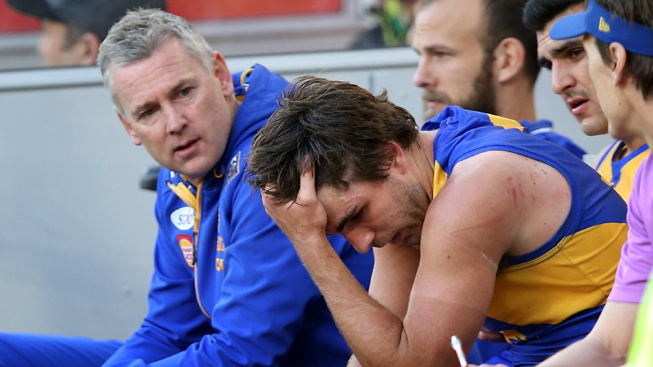 Andrew Gaff dejected on the bench after punching Andrew Brayshaw. Photo: Paul Kane/Getty Images.
