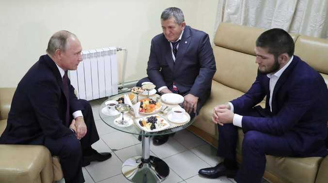 Russian President Vladimir Putin, left, meets with Khabib Nurmagomedov, right, who has won the UFC lightweight title, in Ulyanovsk on the Volga River, Russia, Wednesday, Oct. 10, 2018. Putin defended the fighter's actions in the brawl that followed his victory over Conor McGregor. Nurmagomedov's father Abdulmanap is in the centre. (Mikhail Klimentyev, Sputnik, Kremlin Pool Photo via AP)