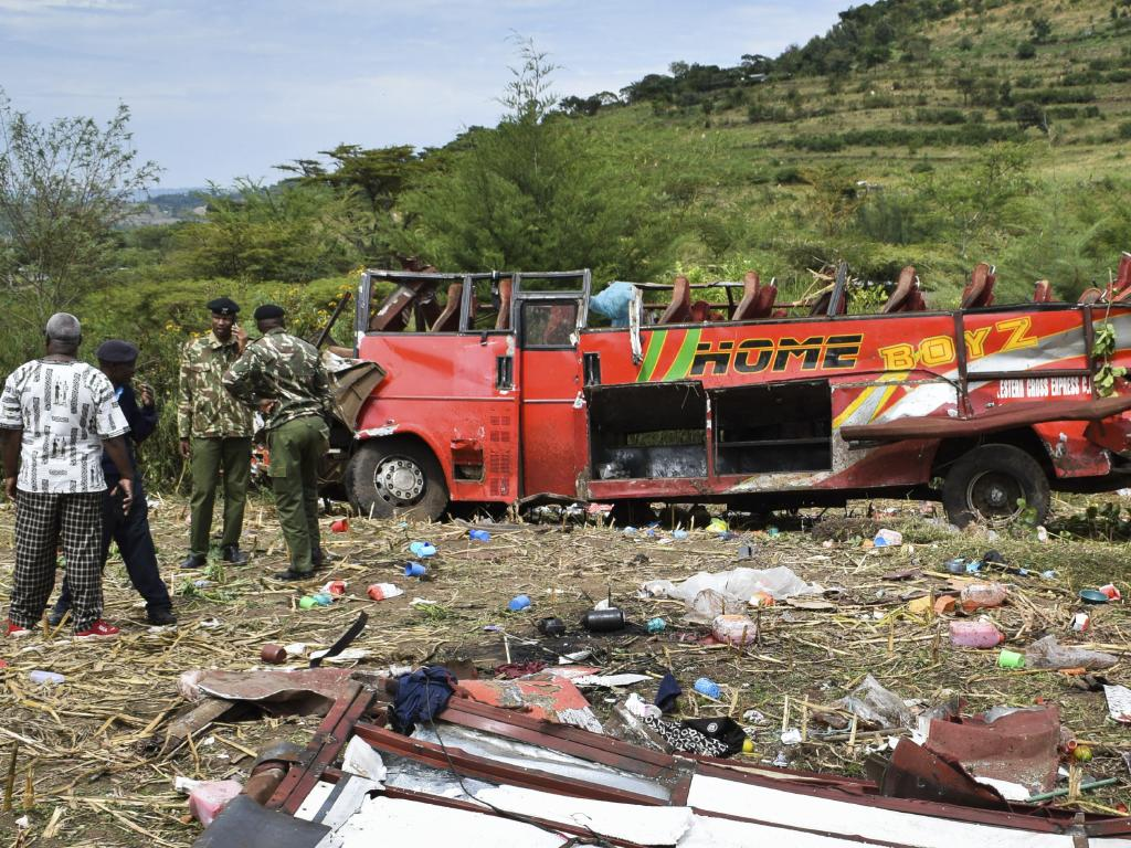 Kenyan police and other rescuers attend the scene of a bus crash near Kericho in western Kenya. Picture: AP