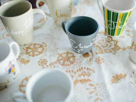 Guests toasted to Brooklyn and Nick on their own personalised second-hand mugs. Picture: Sandra Henri