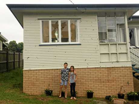 Samuel and Sienna Osborne outside their home which was damaged in the storm.