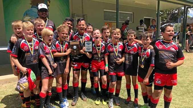 CHAMPIONS: The Under-11 Bowen Seagulls following their thrilling grand final win against the Upper Ross Rams in Townsville.