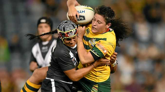 TOUGH FORWARD: Heather Ballinger of the Jillaroos (right) is tackled in an international between the Australian Jillaroos and the New Zealand Kiwi Ferns at Hunter Stadium in Newcastle.