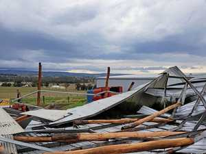 Storm leaves shed smashed as family cleans up