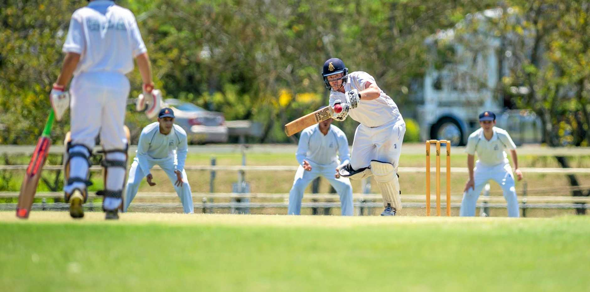 TOUGH CONTEST: Gympie Gold's Lewis Waugh watches the ball on to the bat.