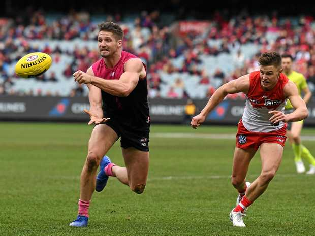 Melbourne's Jesse Hogan, left, looks like staying at the club after Fremantle's withdrawal of interest. Picture: Julian Smith/AAP