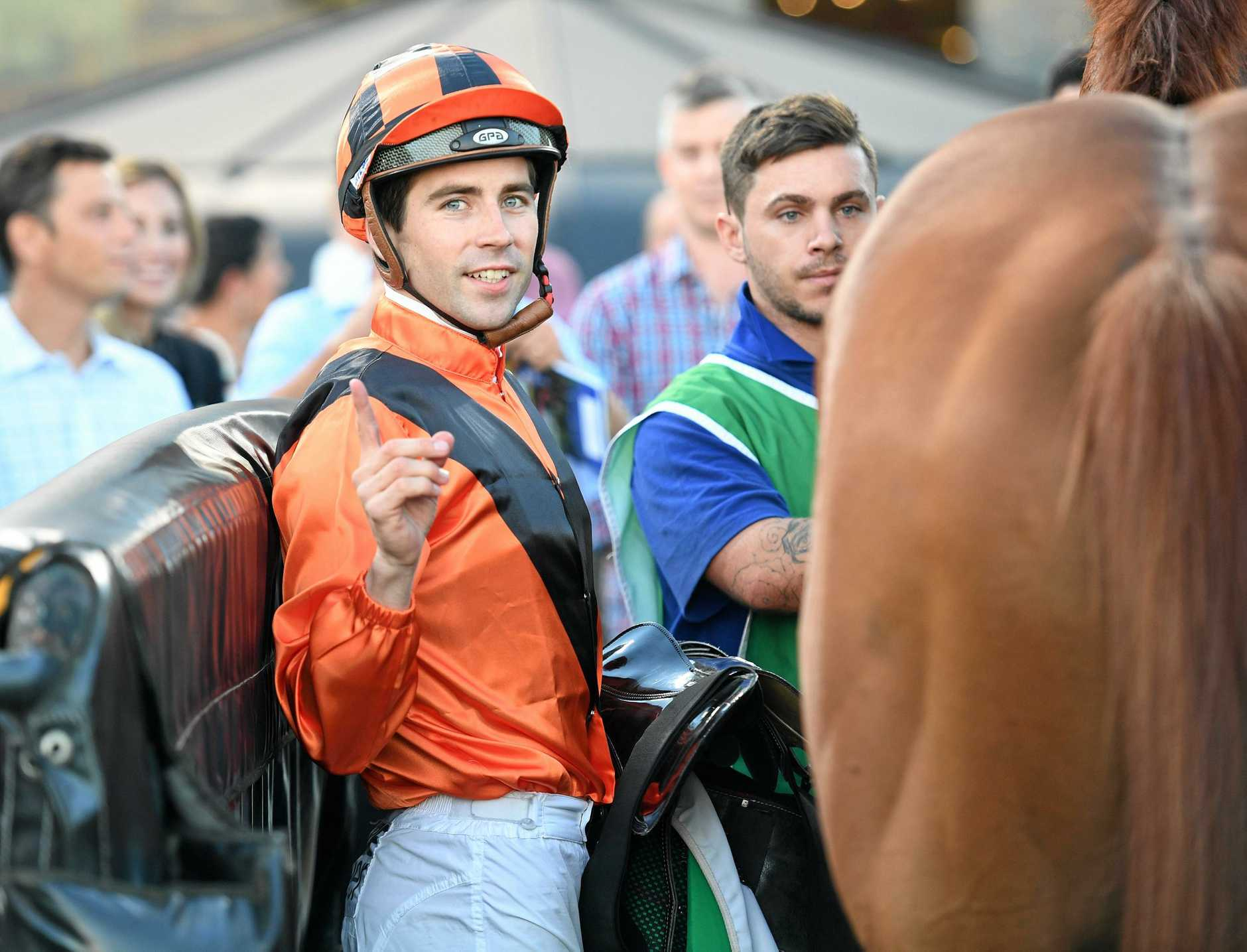 Jockey Adam Hyeronimus returns to scale riding Jemadar to win race 4 the TAB Handicap during Canterbury Park Summer Night Racing at Canterbury Park Racecourse this year.