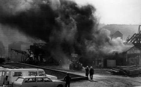 Fire pours out of a shaft at the Box Flat Colliery during the 1972 disaster.