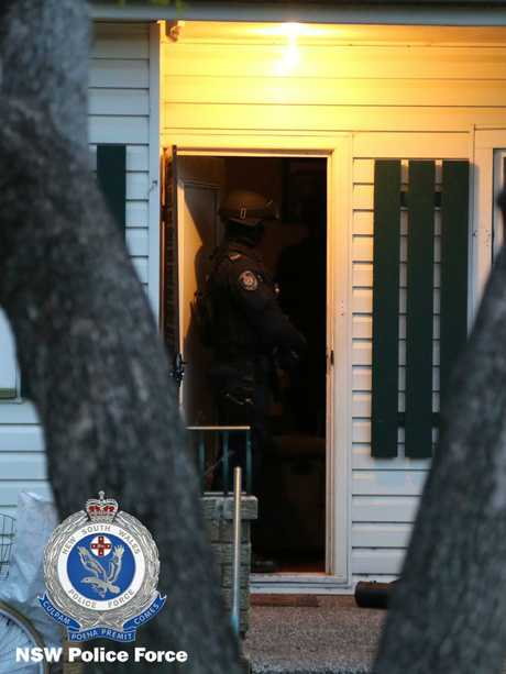 Strike Force Raptor officers enter house.