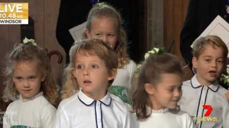 Cheeky Mia Tindall grinned from the back row.