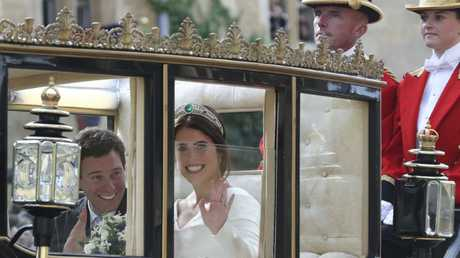 No 'JUST MARRIED' sign on the back? Where is the attention to detail? Picture: AP