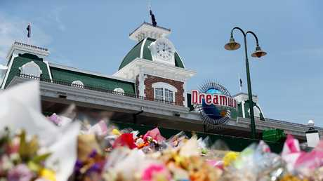 Flowers at the front of Dreamworld following the Thunder River Rapids ride disaster. Picture: Getty Images