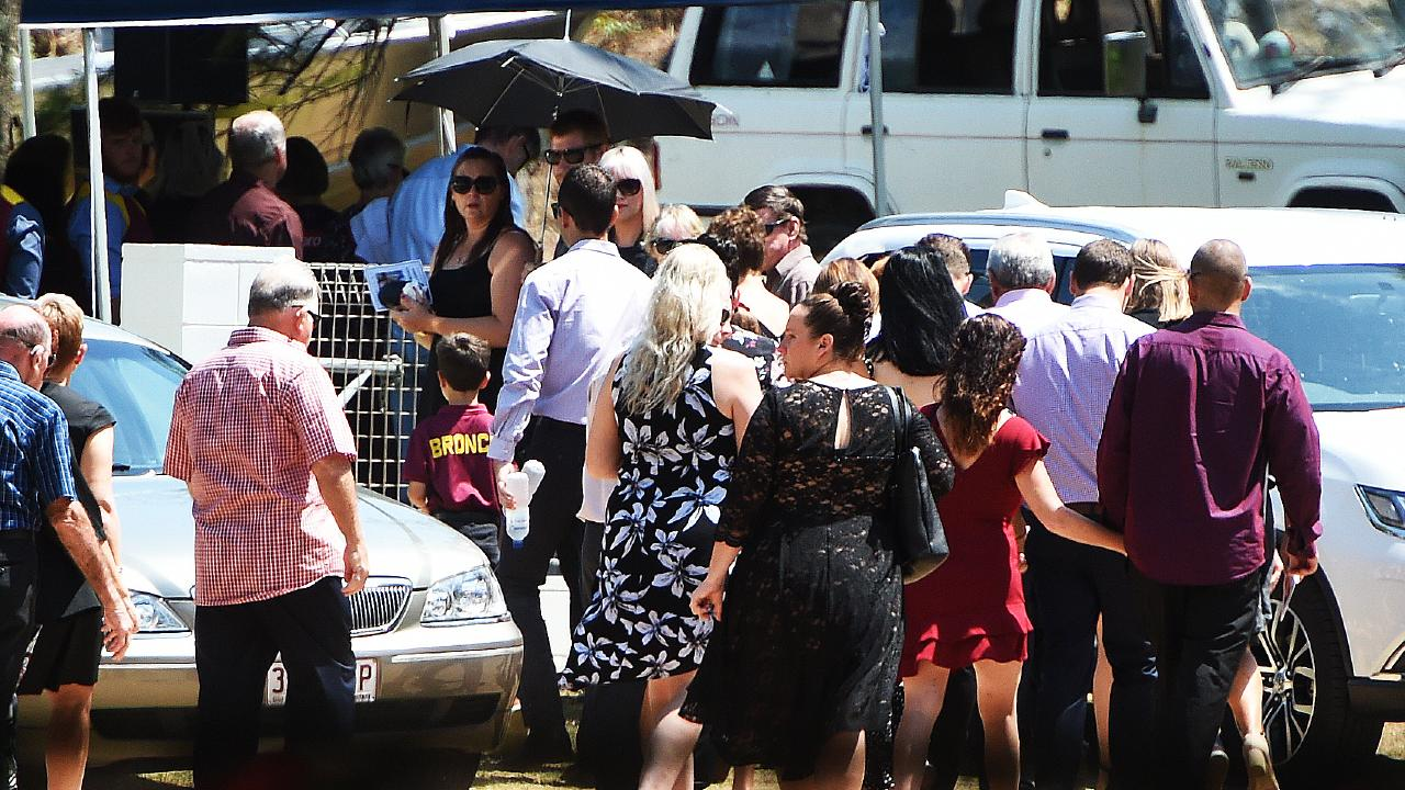 Family and friends of Corey Christensen arrive at the funeral at the Ayr Surf Lifesaving Club. Picture: Zak Simmonds