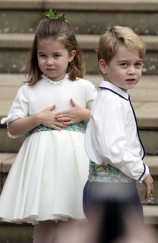 Prince George and Princess Charlotte arrive for the the wedding. Picture: Steve Parsons/Pool via AP