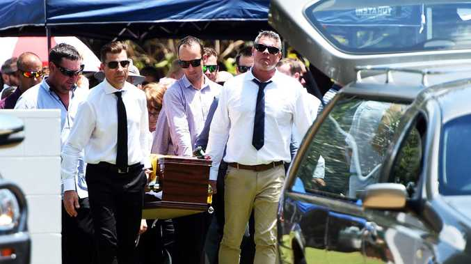 Funeral of Corey Christensen at the Ayr Surf Lifesaving Club, Alva Beach. Friends and family carry the coffin of Corey Christensen. Picture: Zak Simmonds
