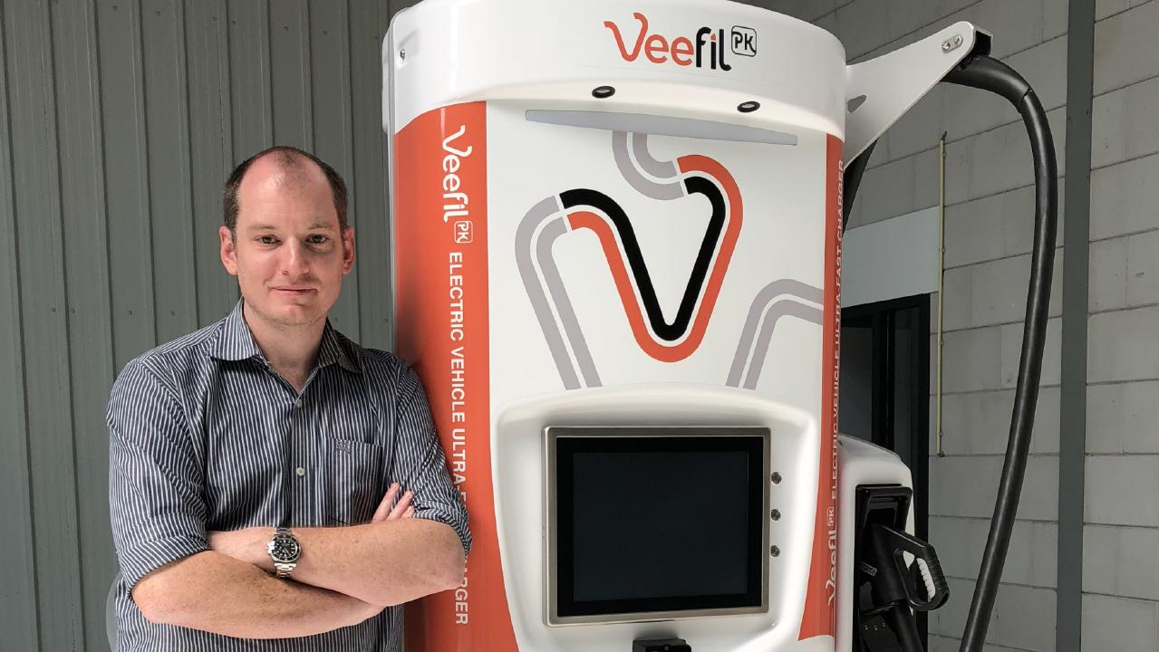 Tritium chief technology officer and founder James Kennedy with a Tritium Veefil charging station.