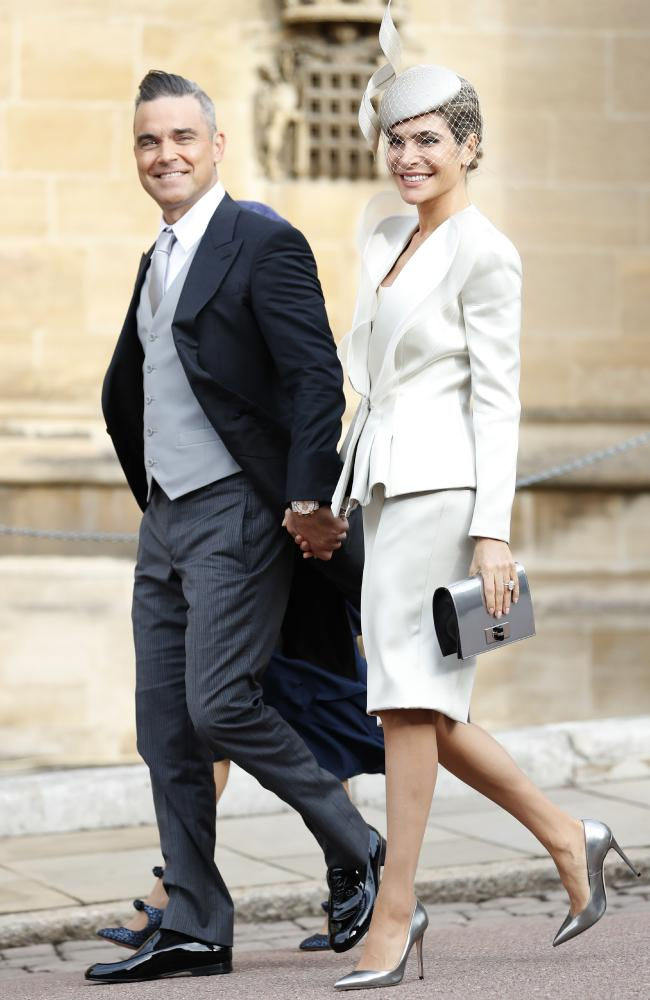 Robbie Williams and Ayda Field are close friends with Princess Eugenie and her longtime partner, Jack Brooksbank. Credit: AP Photo/Alastair Grant, Pool