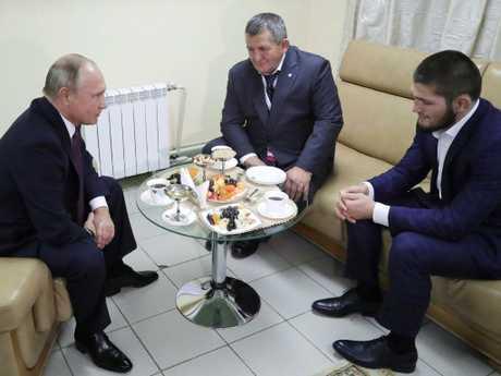 Khabib and his dad with Vladimir Putin.