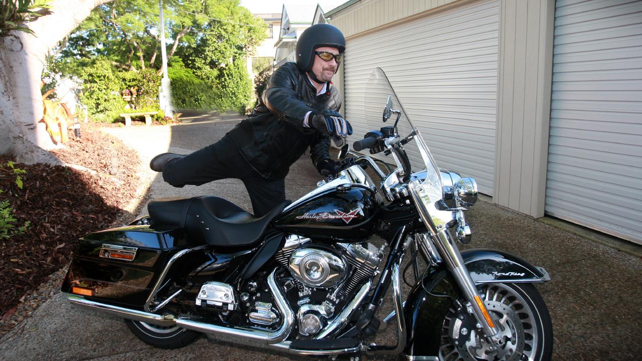 Lev Mizikovsky leaves for work on his Harley Davidson Road King.