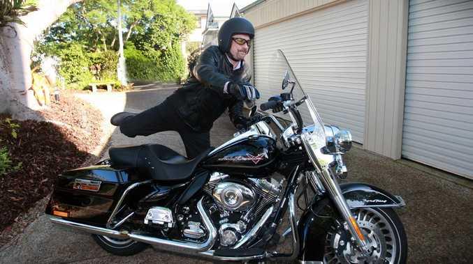Lev Mizikovsky leaves for work on his Harley Davidson Road King.