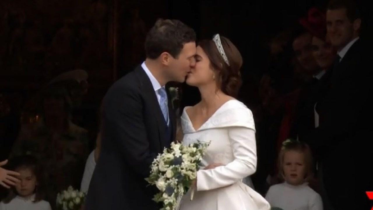 Husband and wife kiss.