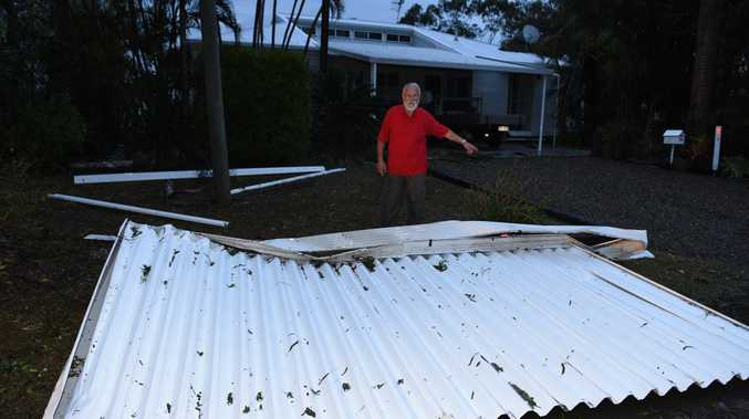 Paul Widmer in his front yard where the patio blew over his house and landed on the side of Maryborough Biggenden Rd