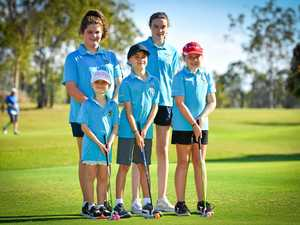 Junior golf tees off