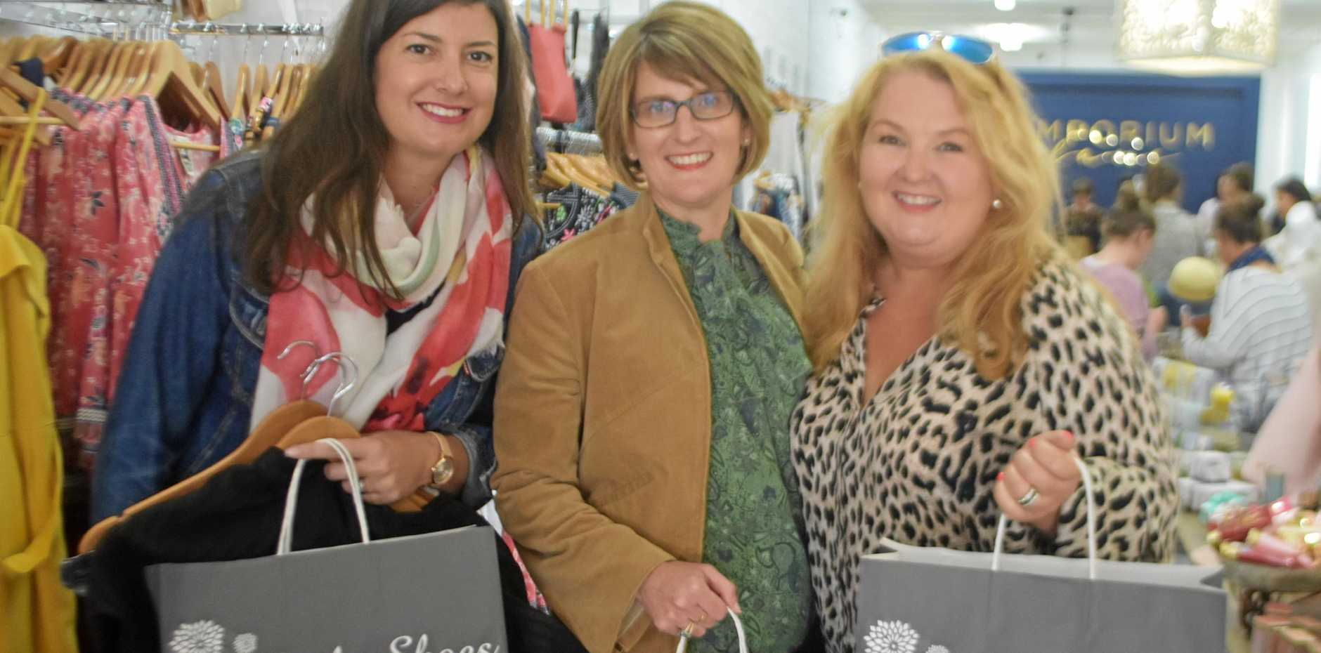 SHOPPING SPREE: Alison Detaille, Janelle Mangan and Kellie McDonald from Brisbane were hitting the shops on Palmerin St to help our farmers.