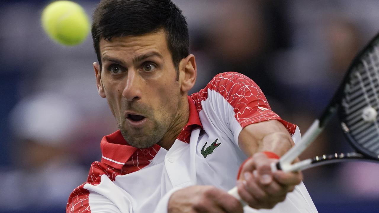 Novak Djokovic hits a return to Alexander Zverev at the Shanghai Masters.