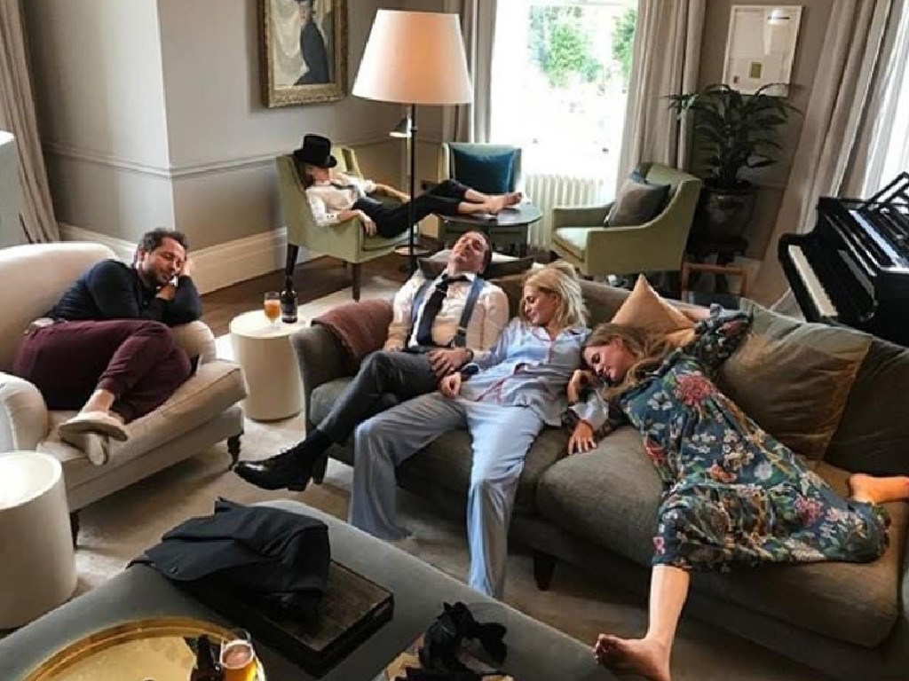 Actor Liv Tyler took this pic of Derek Blasberg, Cara Delevingne, Dave Gardner, Poppy and Chloe Delevingne relaxing after the royal wedding of Princess Eugenie and Jack Brooksbank. Guess it doesn't count if you're back at your hotel room between parties.