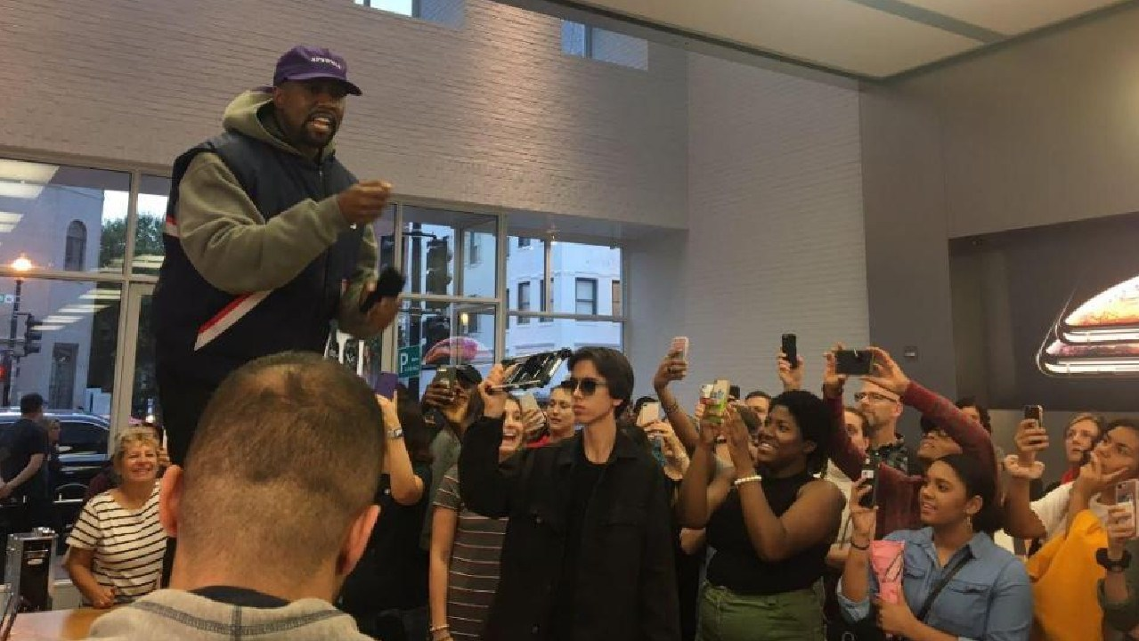 Kanye West makes an appearance at an Apple store.