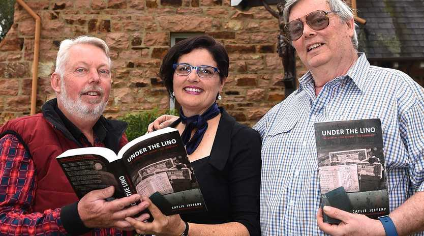 Bruce Morcombe (left) and his brother Perry with author Caylie Jeffery at the launch of her book Under the Lino yesterday. Picture: John Gass/AAP