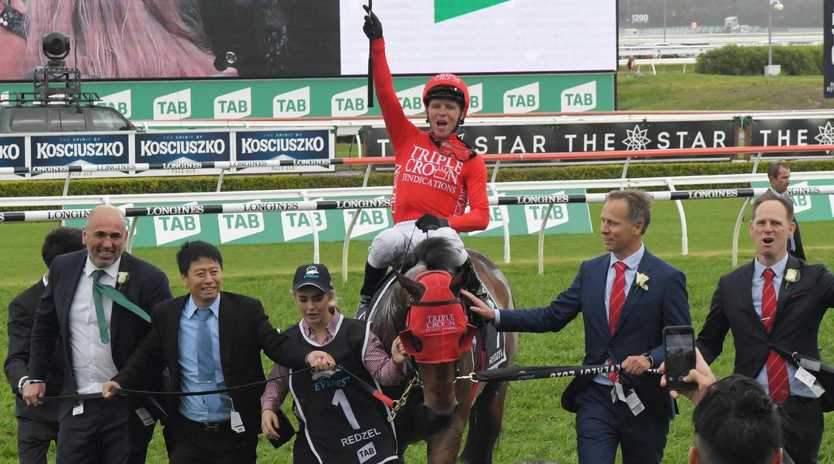 Jockey Kerrin McEvoy and connections after Redzel's victory in The Everest. Picture: Simon Bullard/AAP