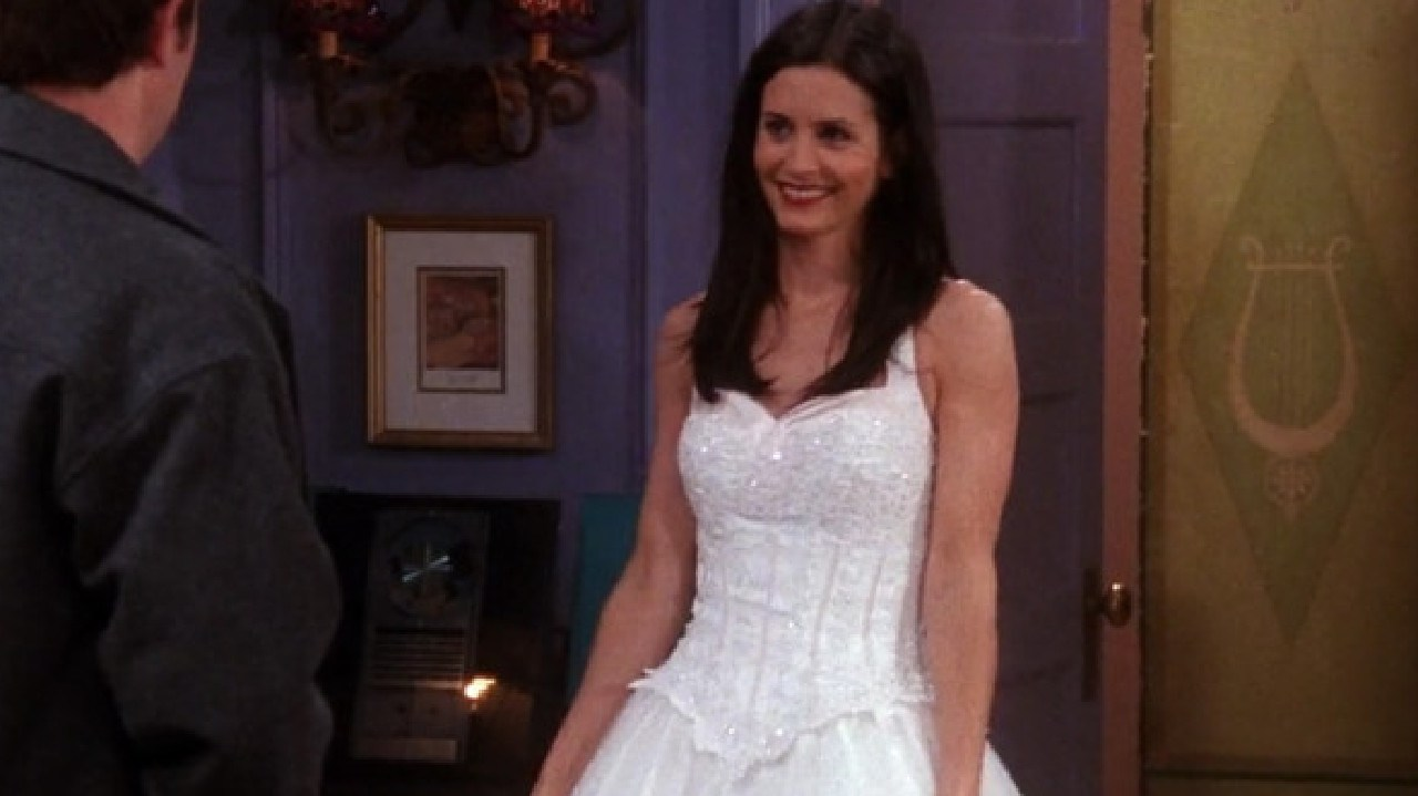 Monica tries the original dress on for Chandler before returning it to Megan.