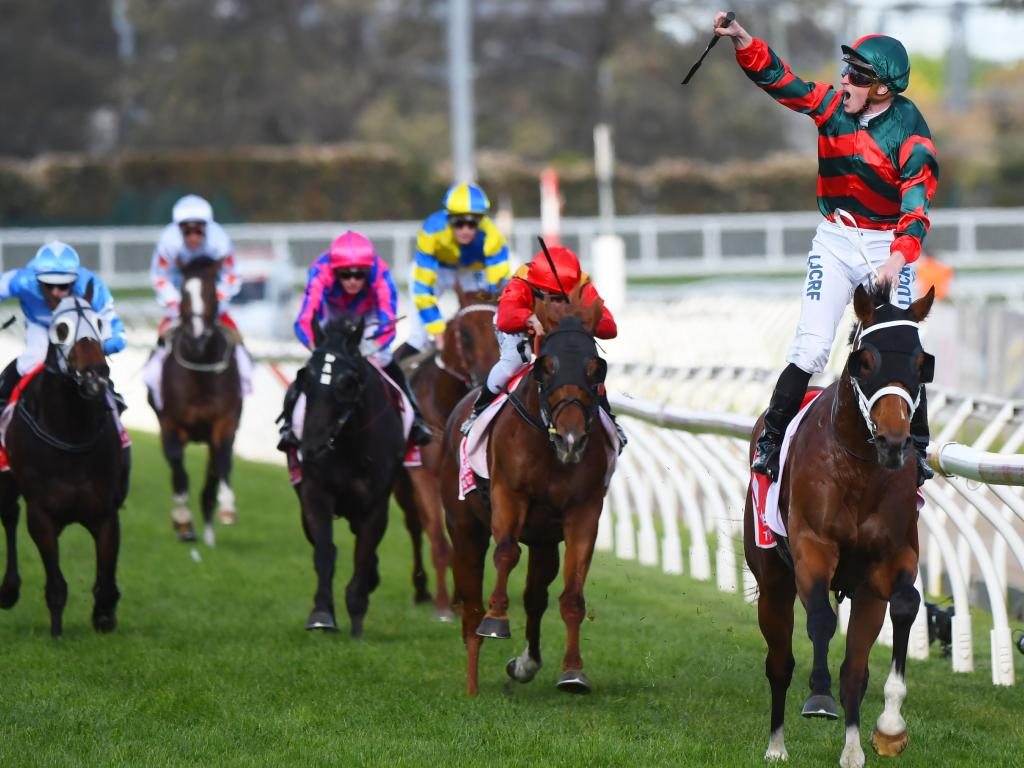 James McDonald celebrates as The Autumn Sun wins the Caulfield Guineas. Picture: Vince Caligiuri/Getty Images