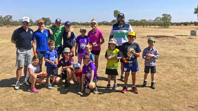 Brookwater Golf and Country Club PGA professional John Collins (left) and PGA trainee Chris Crooks offered free coaching to keen golfers during their recent drought relief tour.
