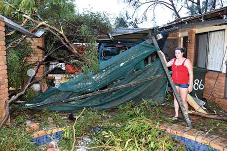 Shania Cameron at her grandparents' house, assessing the damage after a fallen tree crushed her grandparents' car