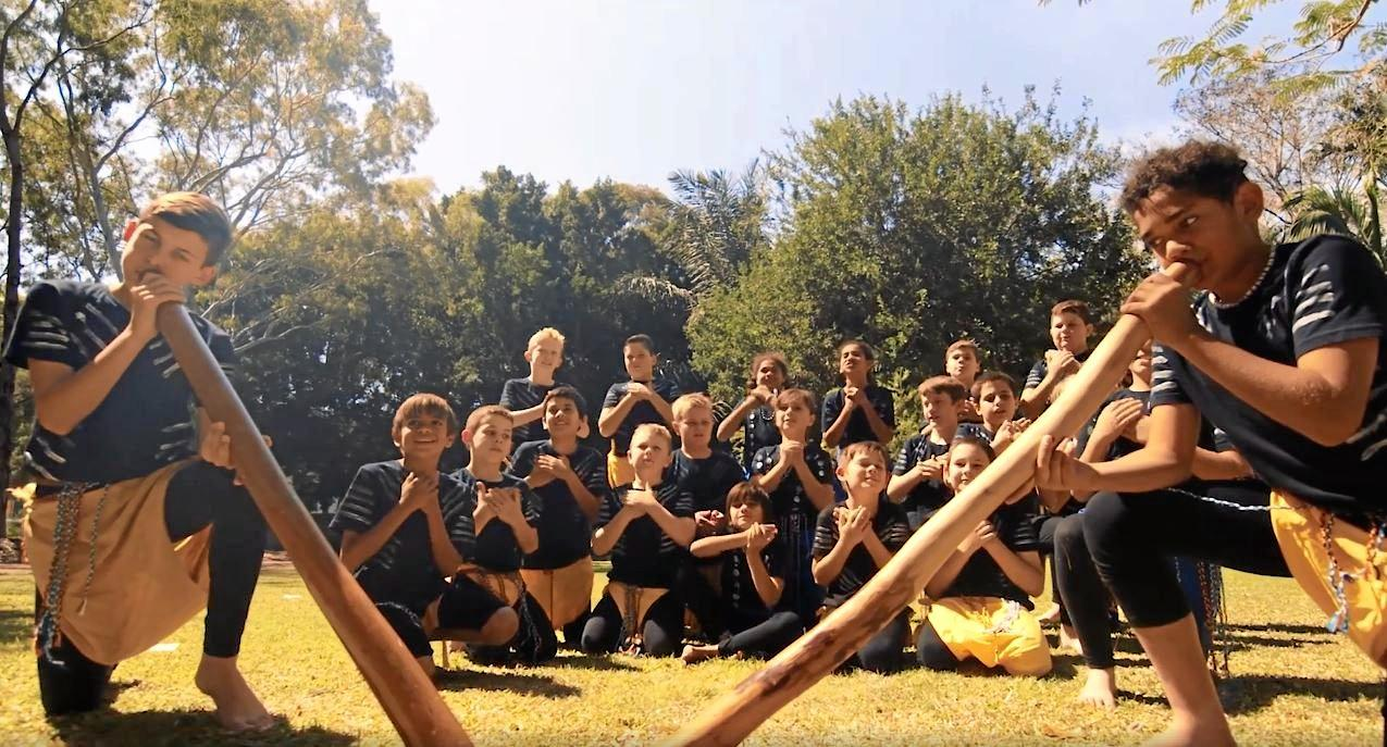 Rockhampton students play the didgeridoo and perform traditional dances in the music video.