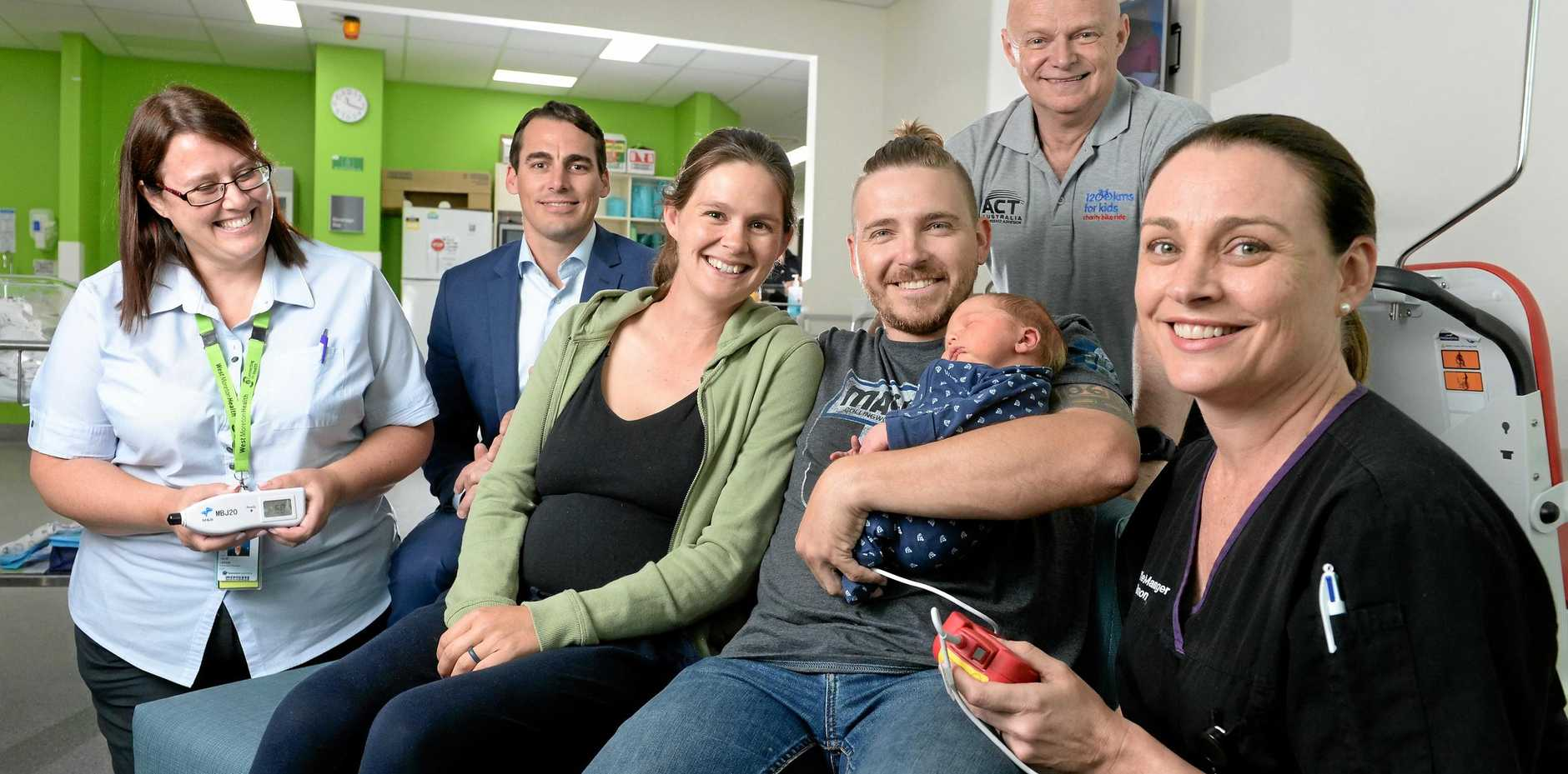 MAKING A DIFFERENCE: Julie Eaton, Shannon Tully, Steve Rainbow and Andrew Coates with new parents Hayley and Steve Kellner with son Percy.