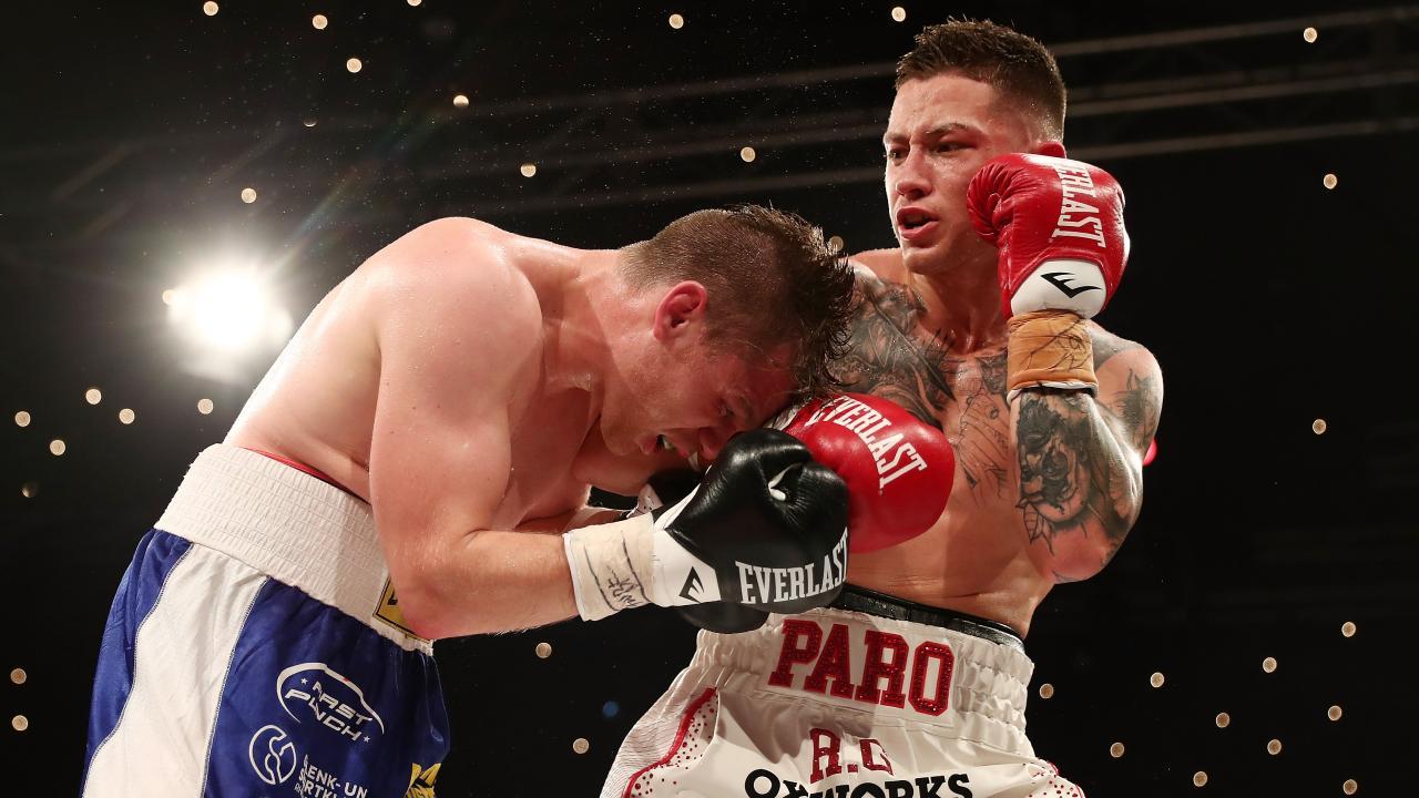 Liam Paro lands a hook against Robert Tlatlik. Picture: Getty