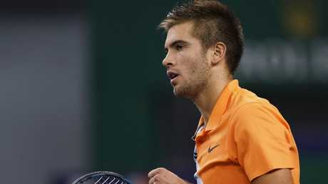 Borna Coric of Croatia reacts after winning a set point against Roger Federer