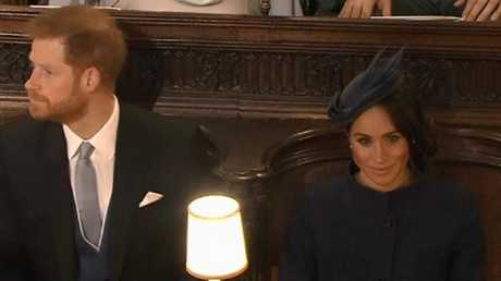 Harry looks away as Meghan stares forward. Picture: Channel 7