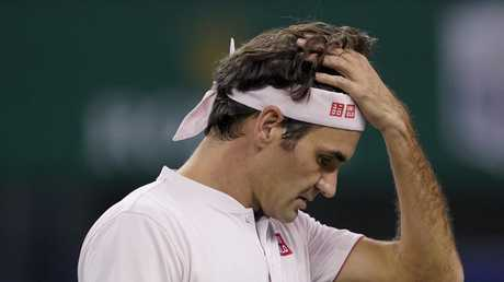 Roger Federer of Switzerland reacts after losing a point to Borna Coric