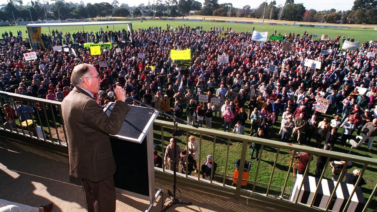 Former Prime Minister John Howard wearing a bulletproof vest at a pro-gun rally in Sale, Victoria.