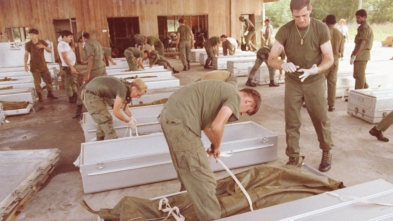 US military personnel place bodies in coffins at the airport in Georgetown, Guyana after the Jonestown massacre. Picture: AP.